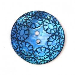 Bouton en nacre gravé bleu...